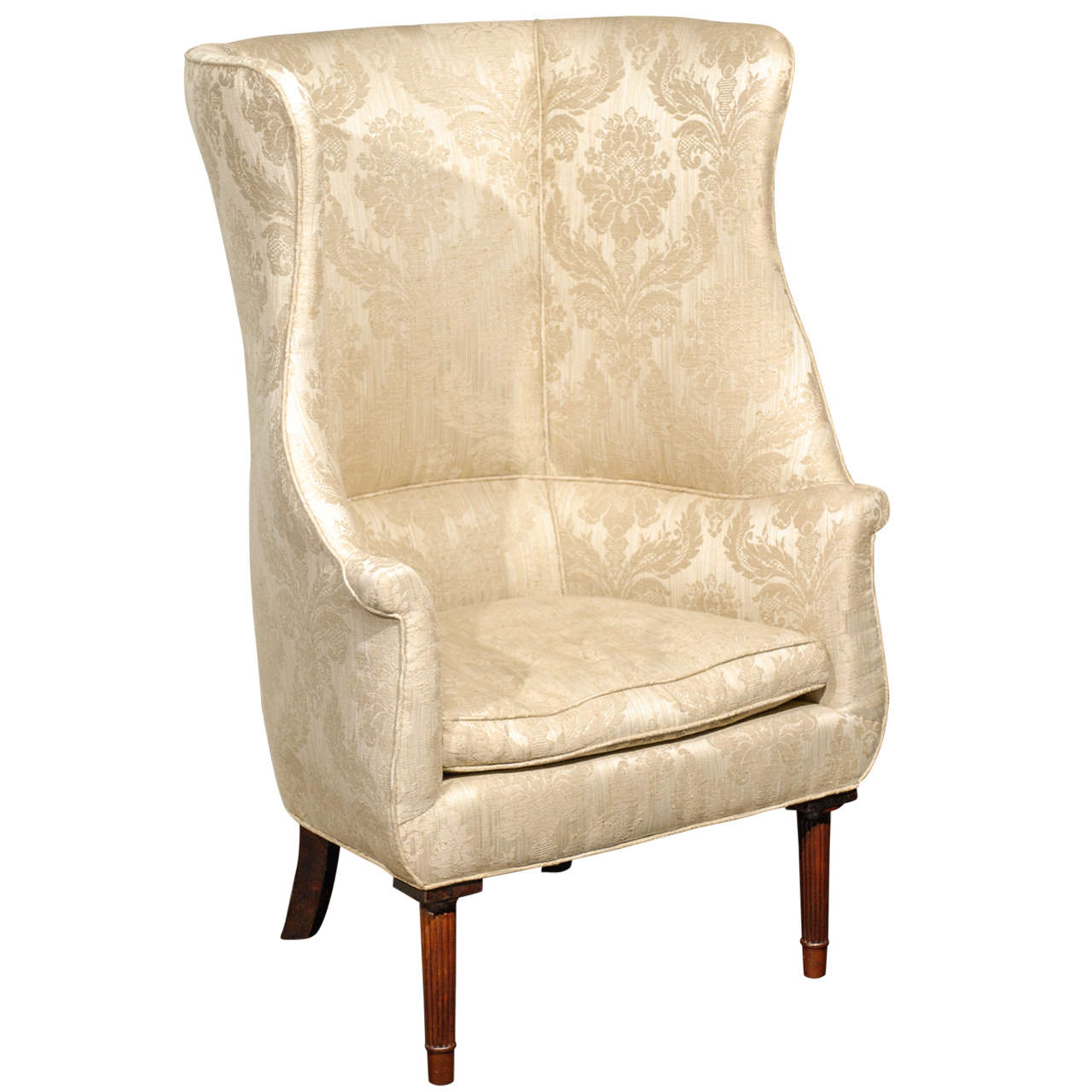 1920s Large Barrel Back Upholstered Wing Chair Raised On Four Reeded Legs English Accent Antiques