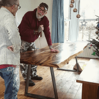 Handmade in Brighton waney edge dining table with butterfly joints bespoke metal trestle legs