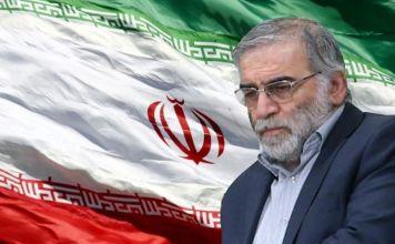 Fotografía de Mohsen Fakhrizadeh sobre una bandera de Irán