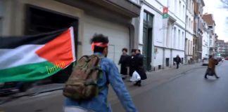Hermanos gemelos de Gaza que buscaban asilo en Bélgica se filmaron a sí mismos patinando por un barrio judío de Amberes con una bandera palestina.