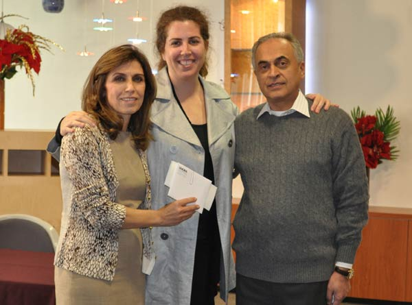 Fred and Jilla Farzan of Nora Lighting prasent a donation to Linda Karchem