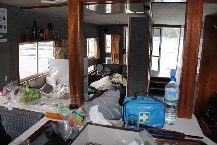 The main cabin of the boat with kitchen and loungeroom.