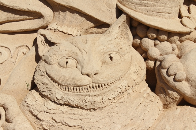 Cheshire Cat sculpted from sand.