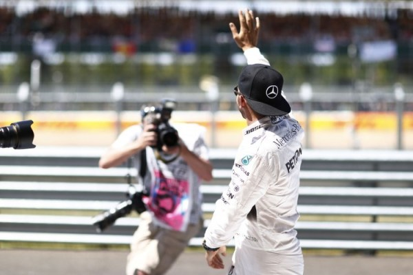 Lewis Hamilton waving to fans at Silverstone