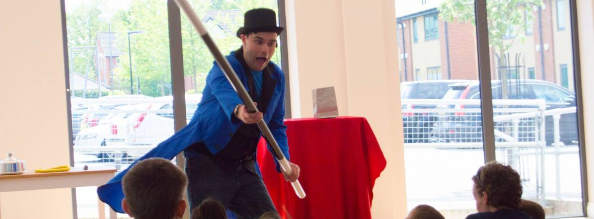 Tom Tricks performing his magic show for a kids party
