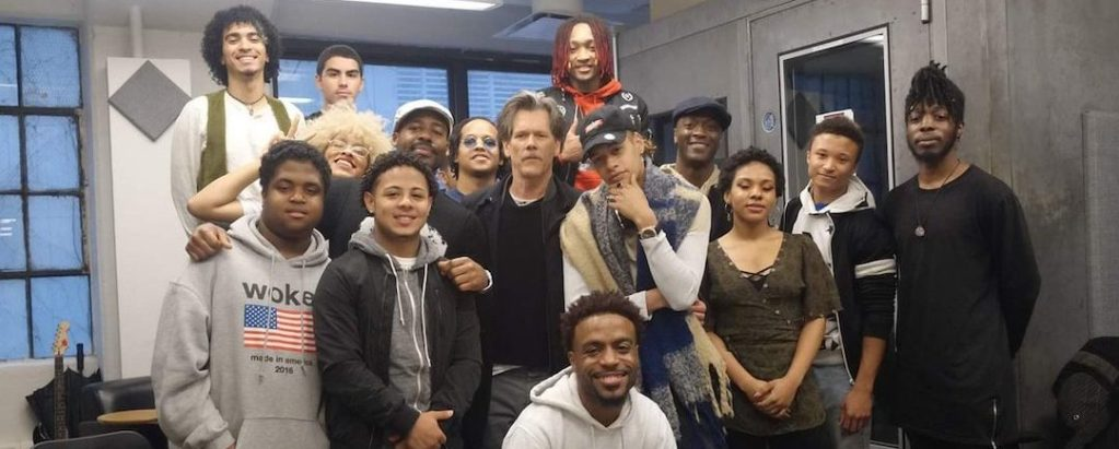 Kevin Bacon with students at The Door