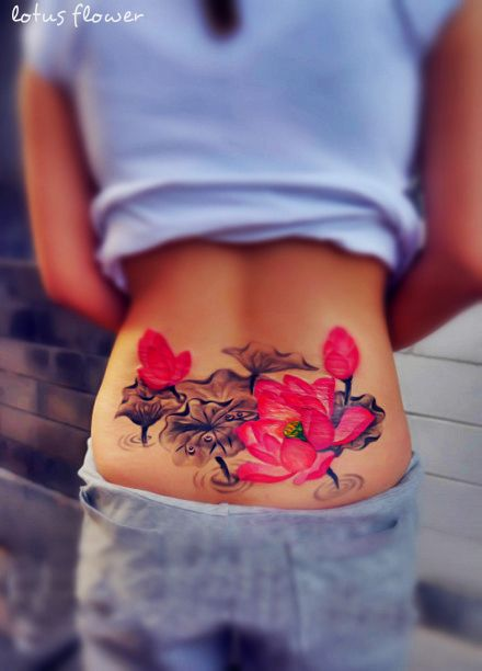 pretty watercolor paint pink black flower tattoo on lower back