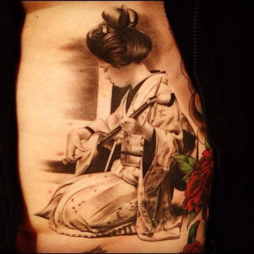 Black and gray geisha girl tattoo with musical instrument