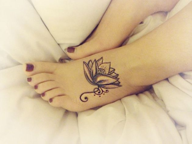 glamorous and stunning lotus flower black and white tattoo on foot