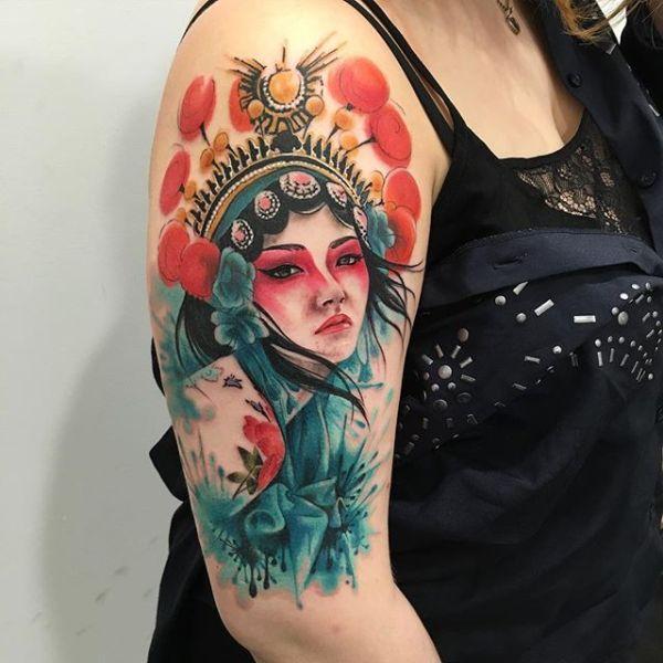 Realistic sad geisha tattoo