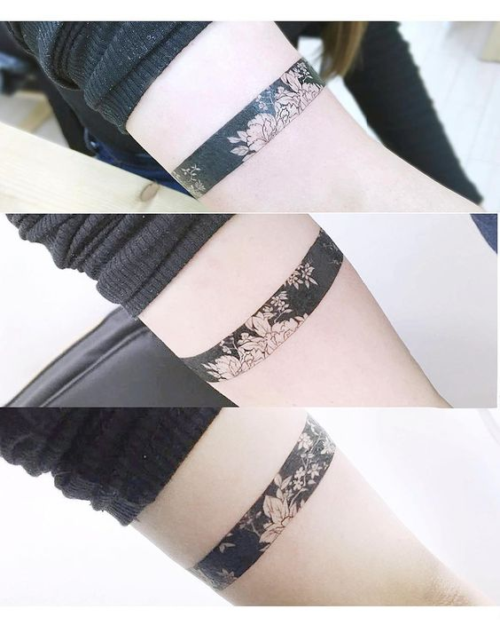 subtle black and white flower armband tattoo