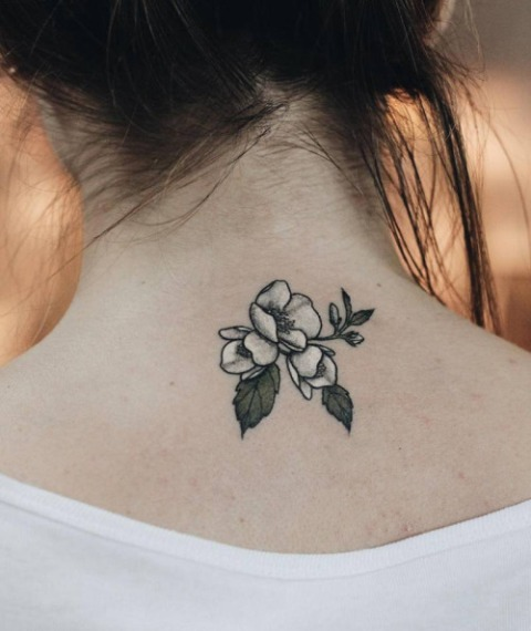 flower back neck tattoo