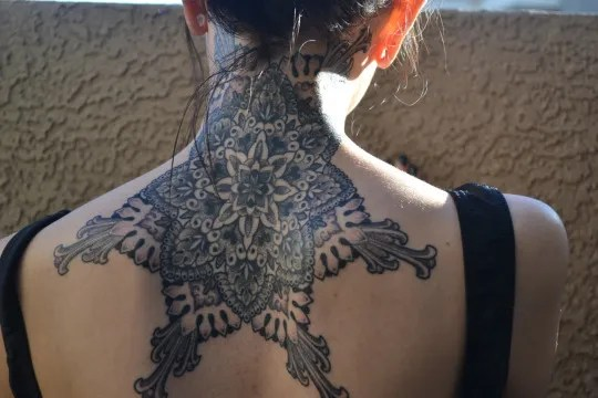 Mandala flower tattoos designs on Neck and upper back ideas for women