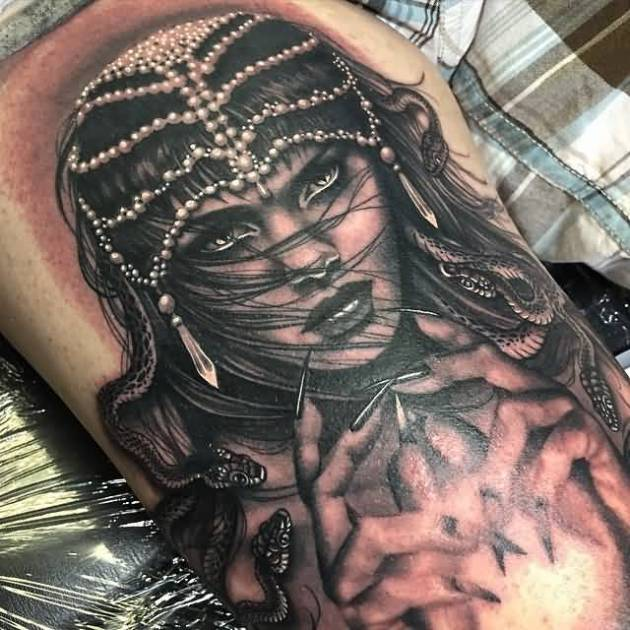 black-grey witch tattoo on thigh