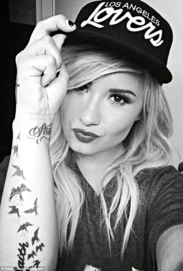 Demi Lovato flock of birds tattoo