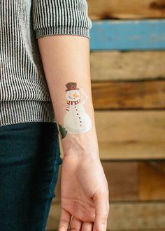 snowman tattoo on arm