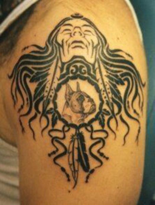 tribal native american ink tattoo on shoulder