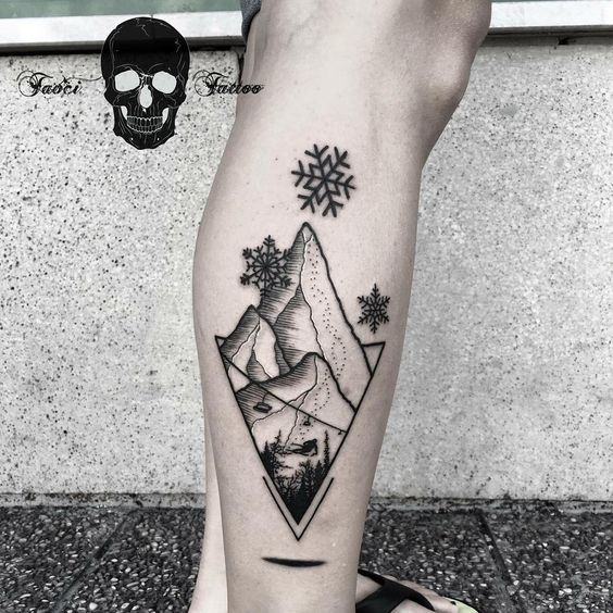 winter mountain snowflakes skiing tattoo