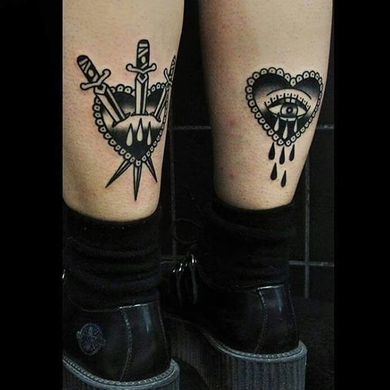 traditional style heart tattoo on legs