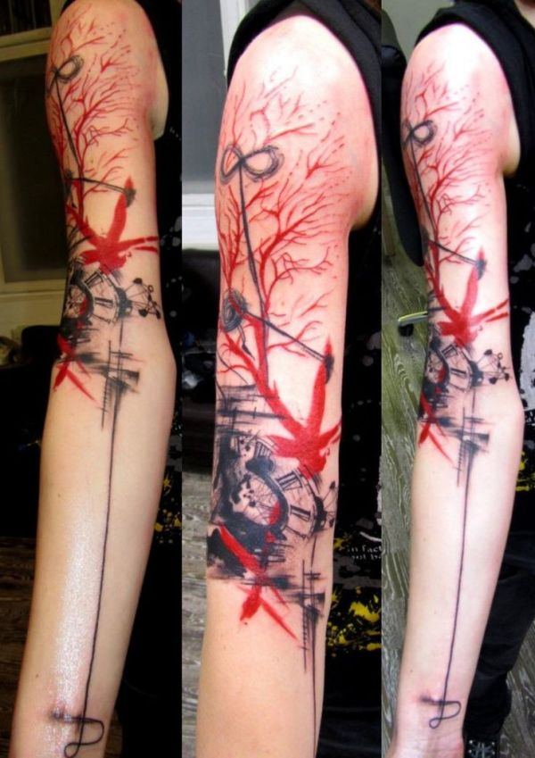 black and red tattoo on full arm