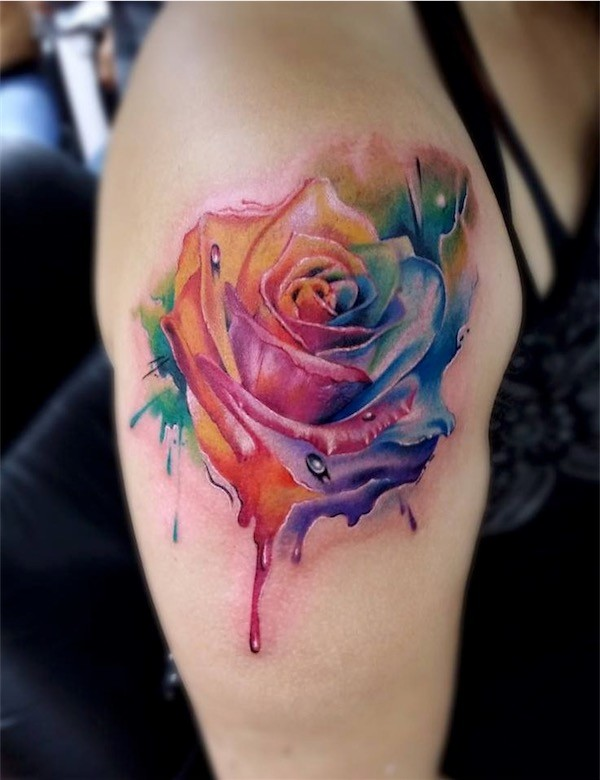 rainbow rose tattoo on shoulder