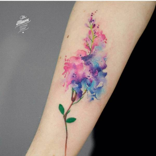 watercolor flower tattoo on inner arm