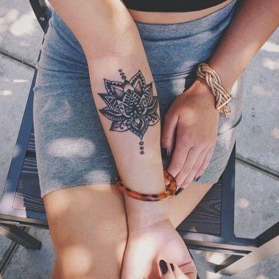 mandala tattoo on forearm