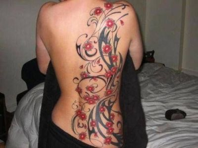 red flowers tribal tattoo on back