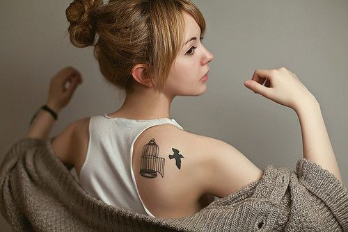 bird out of cage tattoo for women on back shoulder