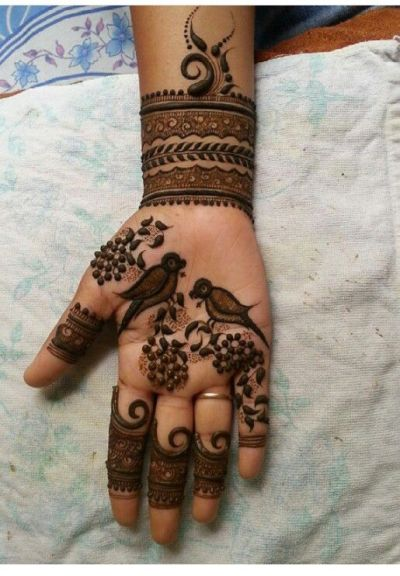 elegant birds and swirls mehndi design on front hand for girls