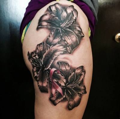 grey tiger lily flowers tattoo on side thigh