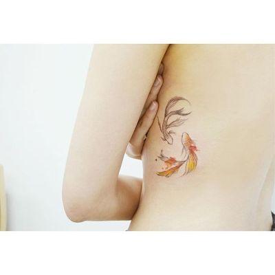 small koi fish tattoo ideas on rib cage for women
