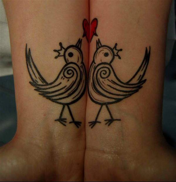 black and white outlined love birds tattoo on wrists for couples