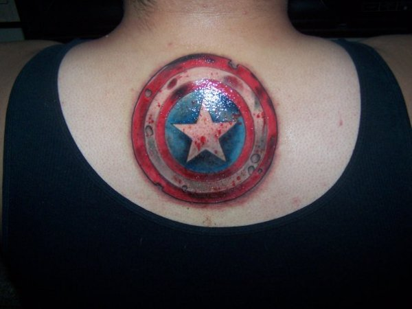 glowing captain america shield tattoo on back for women