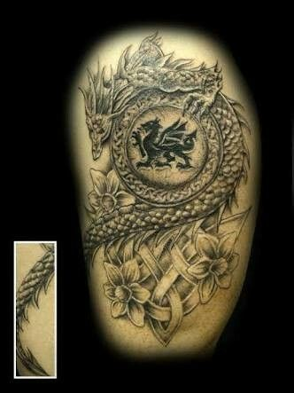 dragon shield with daffodils tattoo for men sleeve