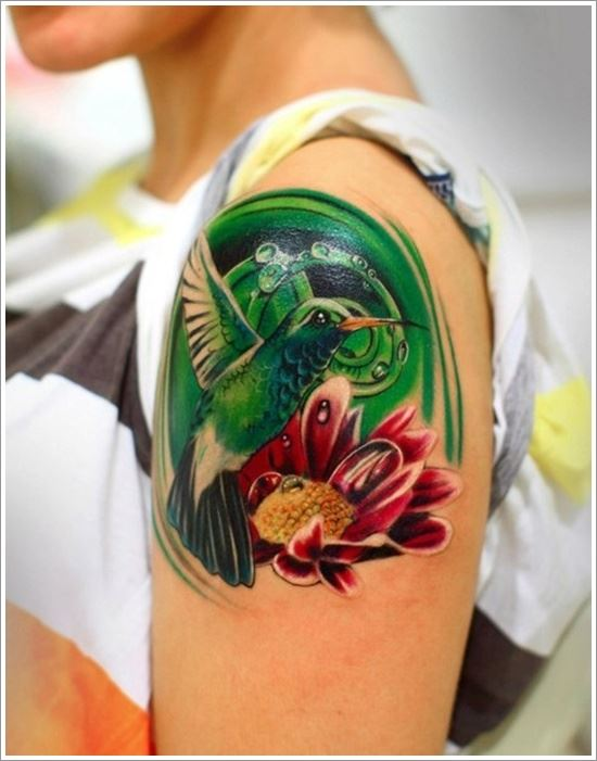 female quarter sleeve hummingbird and flower tattoo