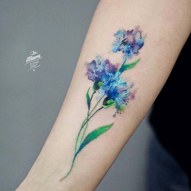 attractive watercolor conflower tattoo on forearm