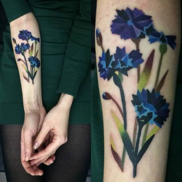 watercolor ink cornflower tattoo on forearm