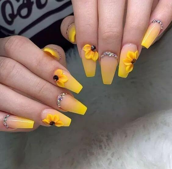 yellow coffin nails with sunflower designs
