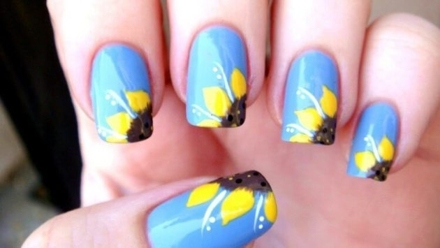 blue nails with yellow flowers