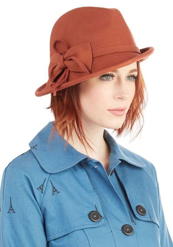 girl with short hair wearing hat and winter dress