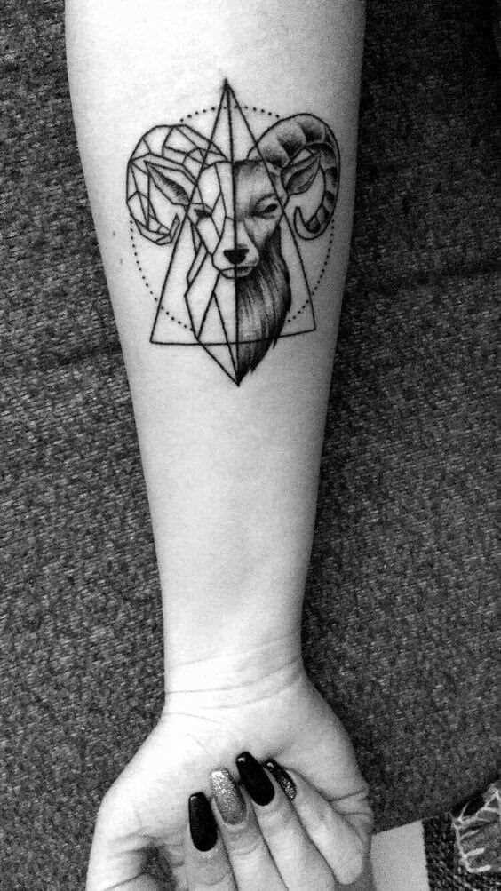 goat head inside a triangle tattoo design on forearm