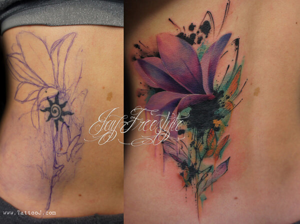 watercolor lower back cover up flower tattoo design