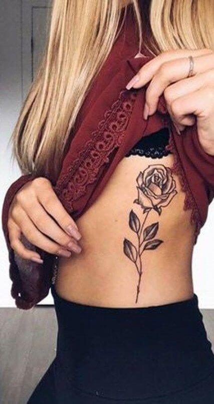 rose tattoos on side stomach for girls