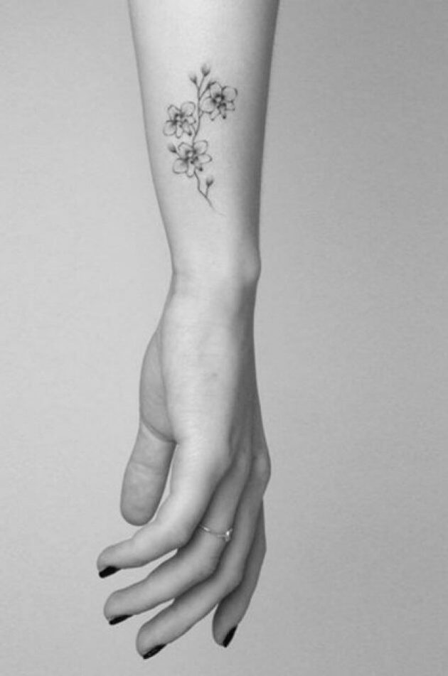 side wrist jasmine flower tattoo