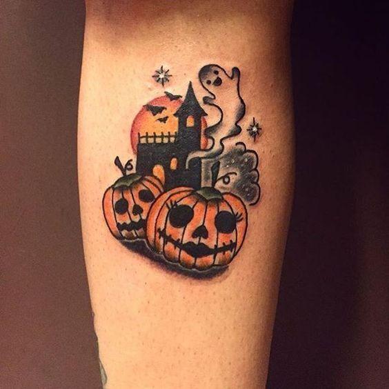 haunted halloween themed tattoo