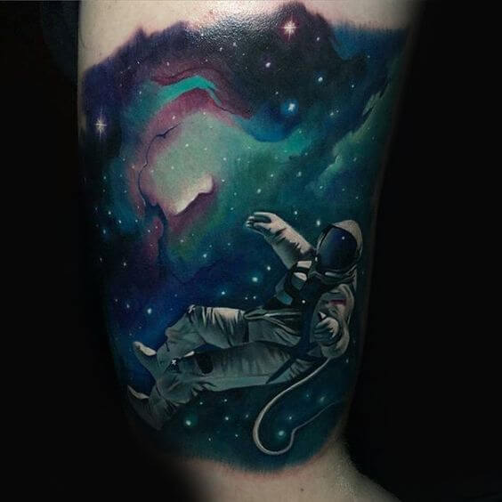 astronaut floating in space tattoo design