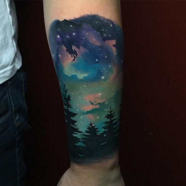 northern lights astronomy tattoo ideas on arm