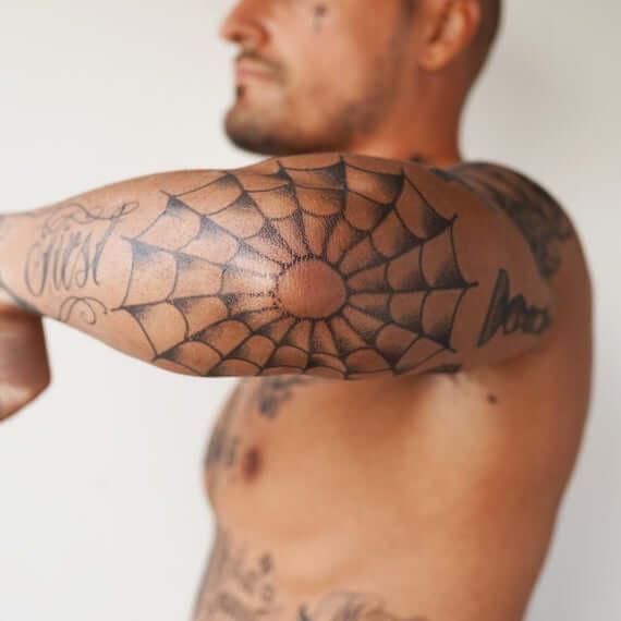 spider web elbow tattoo idea