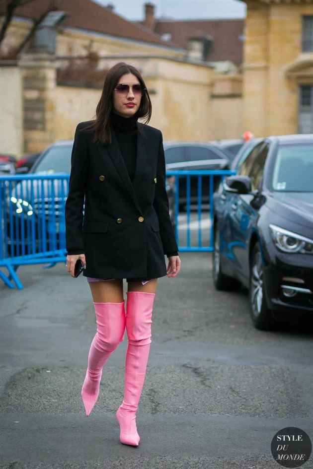All black outfit with light pink thigh length winter boots